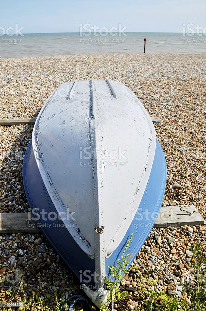 Upside down boat on beach royalty-free stock photo