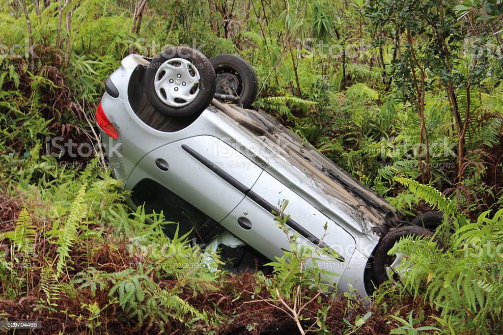 Upside down car from tropical storm in Reunion Island stock photo