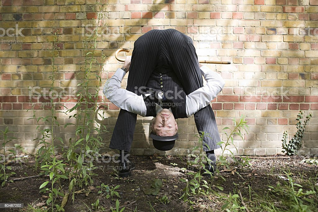 Upside down contortionist stock photo