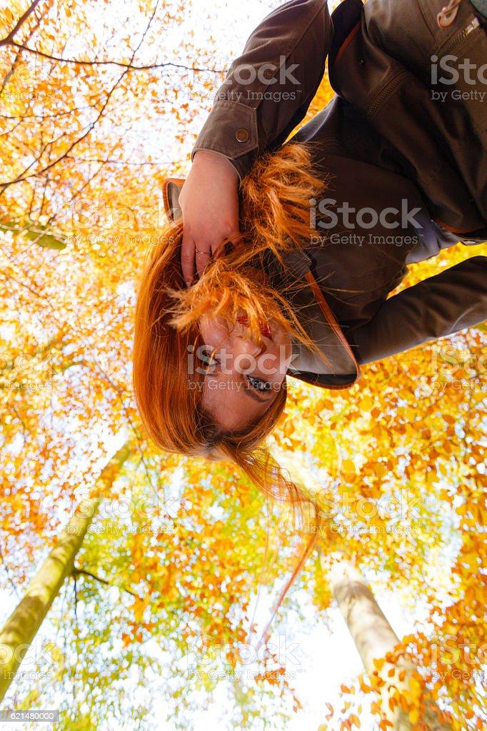 Upside down ginger hair girl. stock photo