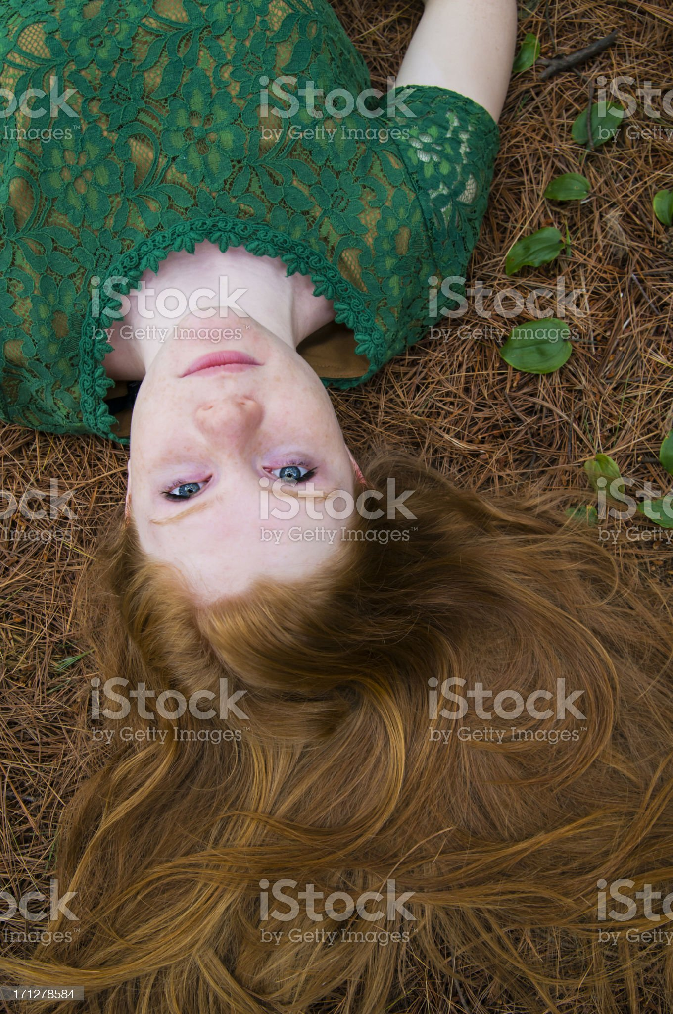 Upside down girl with rich natural long red hair. royalty-free stock photo