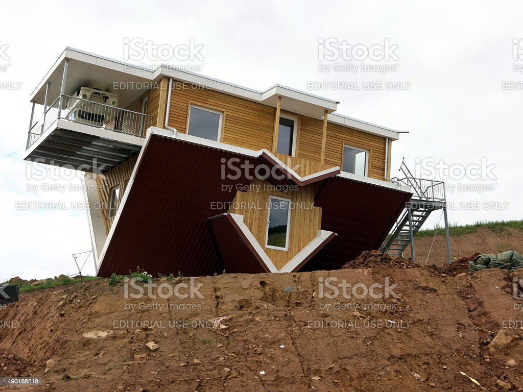 upside down - headstand of a house stock photo