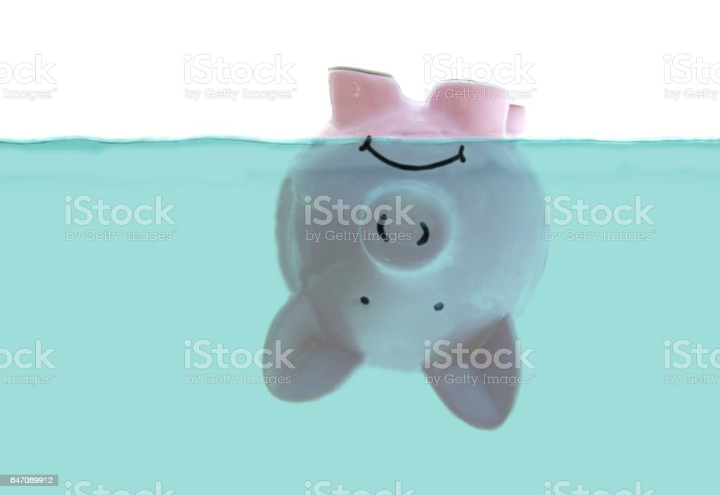 Upside down piggy bank stock photo