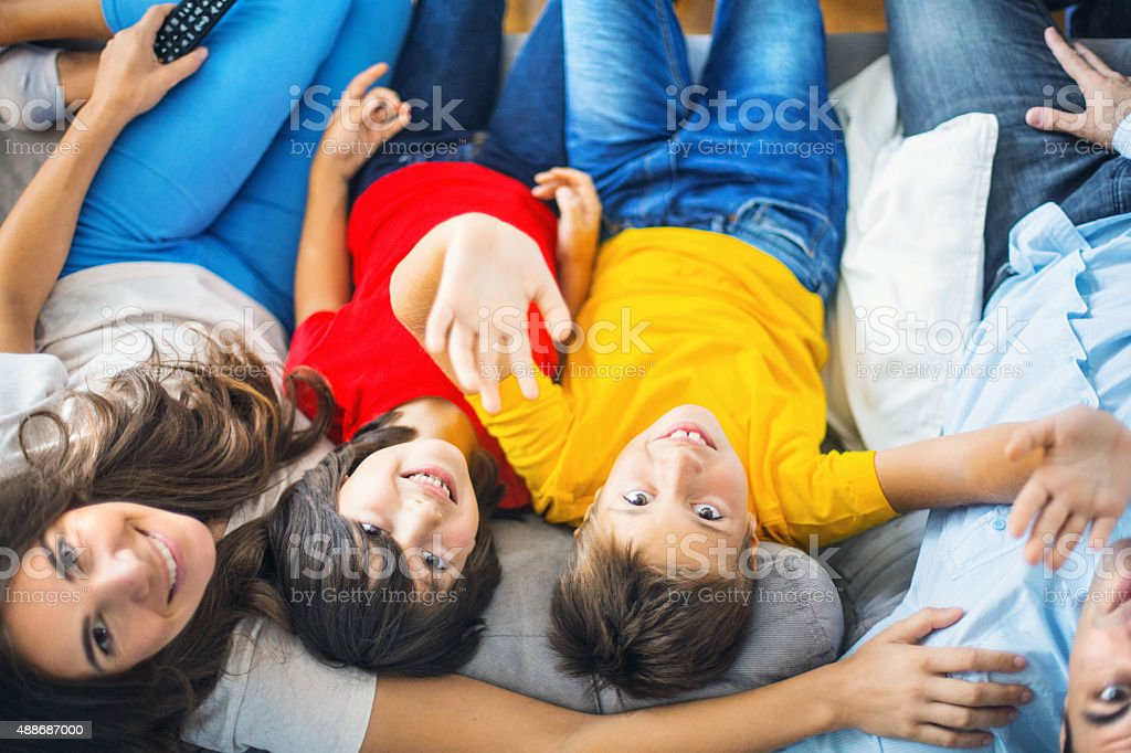 Upside down portrait of young happy family. stock photo