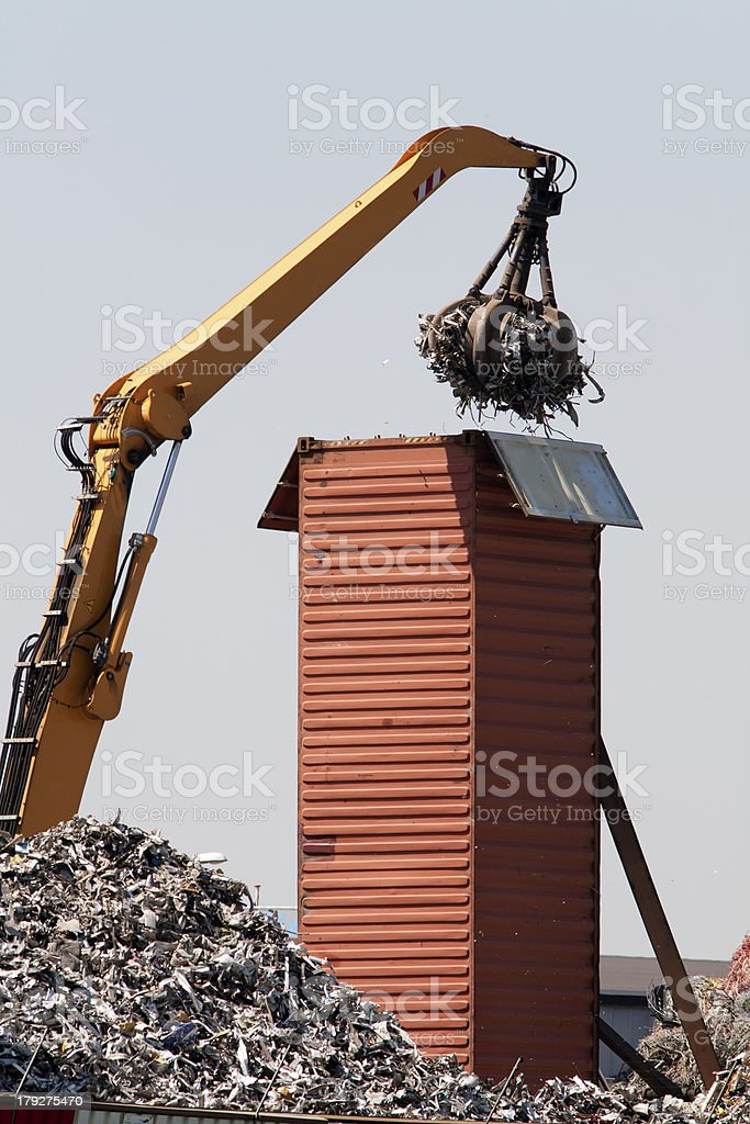 Upstanding cargo container getting loaded with metal scrap royalty-free stock photo