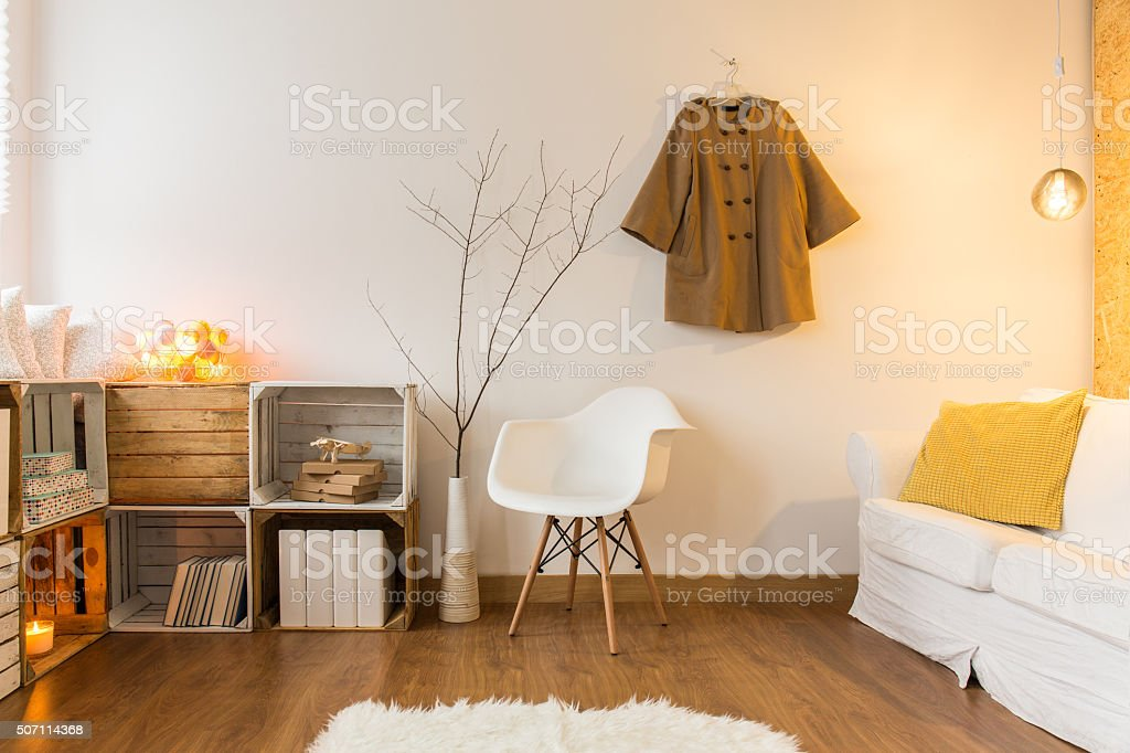 Up-to-date designed big lounge with sheepskin on floor stock photo