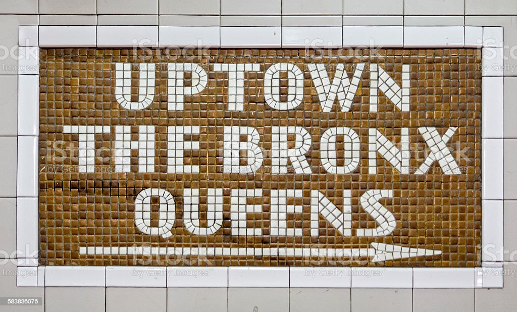 Uptown New York Sign in Tile stock photo