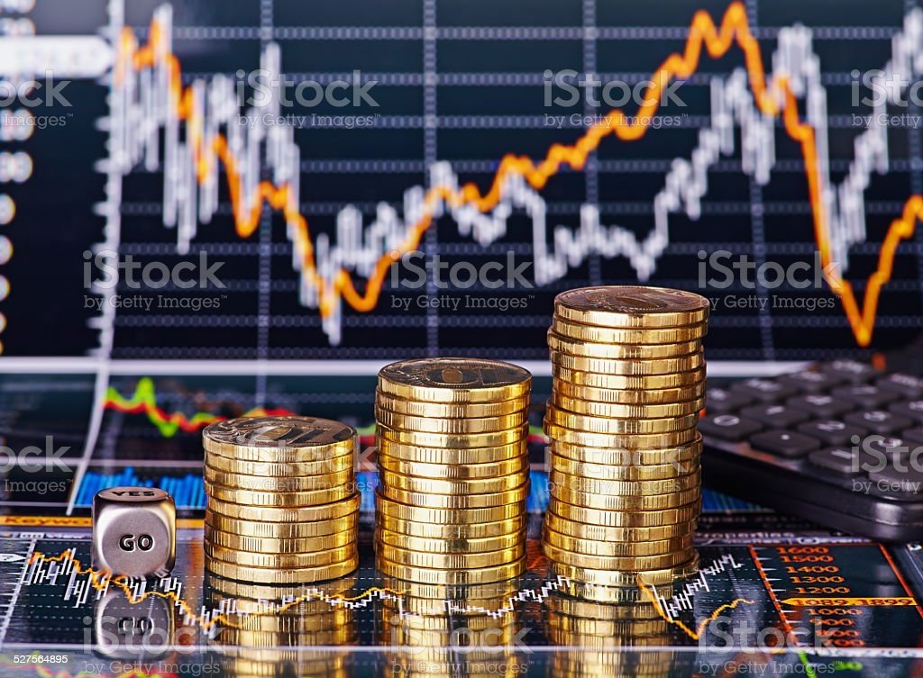 Uptrend stacks coins, dices cube  GO and calculator stock photo