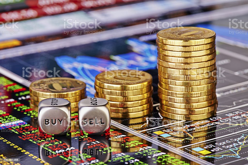 Uptrend stacks coins, dices cubes with the words SELL BUY stock photo