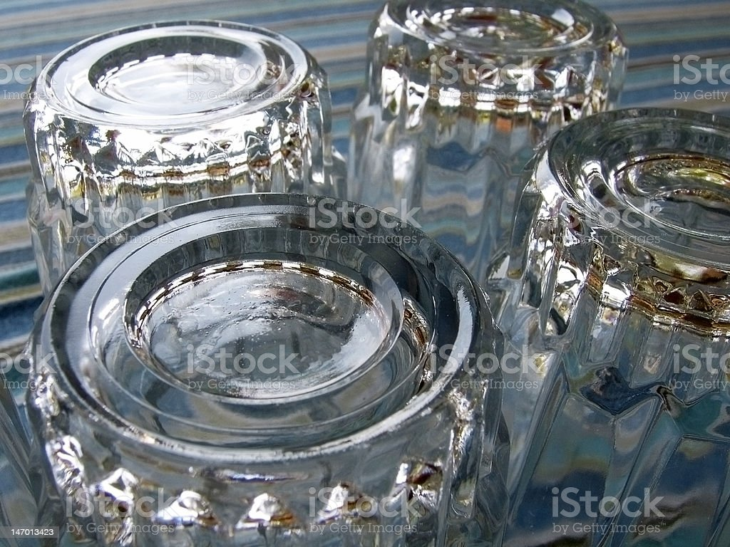 Upturned drinking glasses stock photo