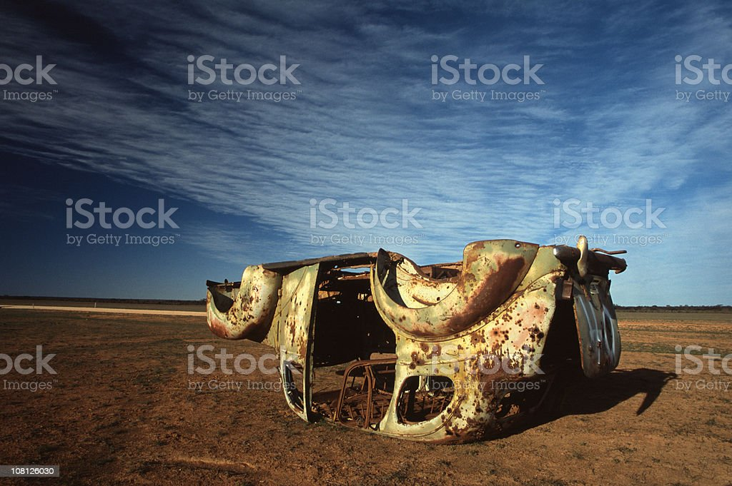 Upturned, Rusty and Old Car in Desert Australian Outback royalty-free stock photo
