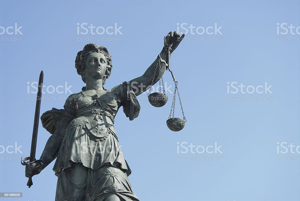 Upward perspective of Statue of Justice against the sky stock photo