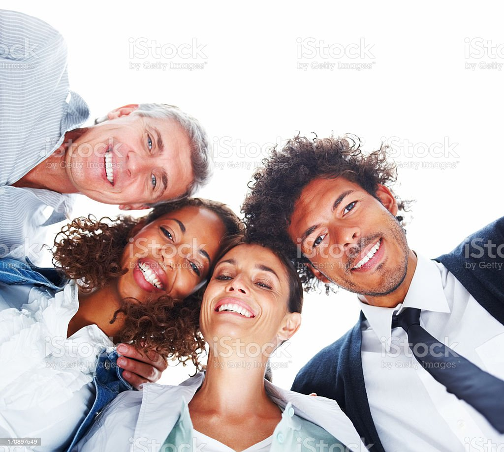 Upward view of business people standing together on a white background stock photo