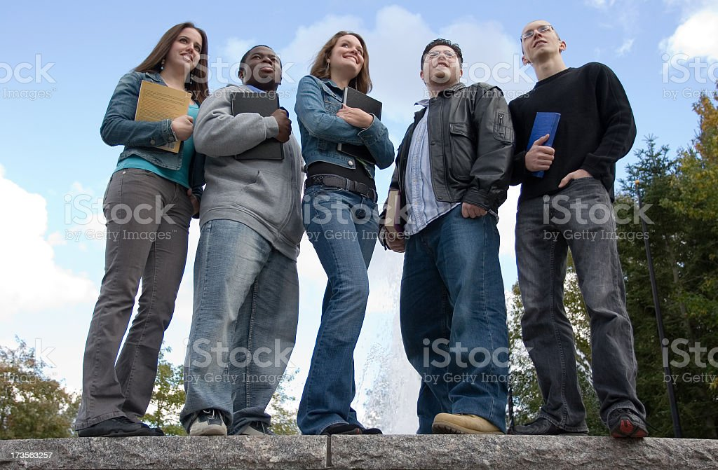Upward view of smiling college students stock photo