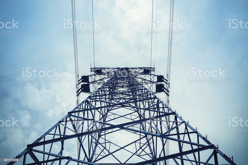upward view of the power transmission tower stock photo