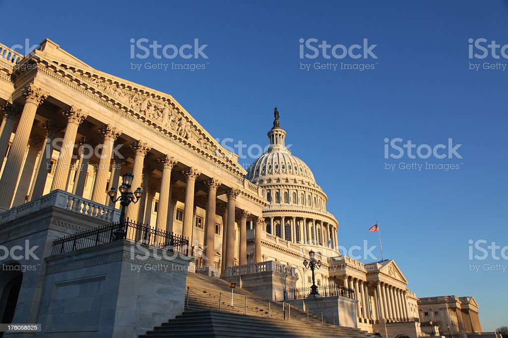 Upward view of the US Congress building during sunrise stock photo
