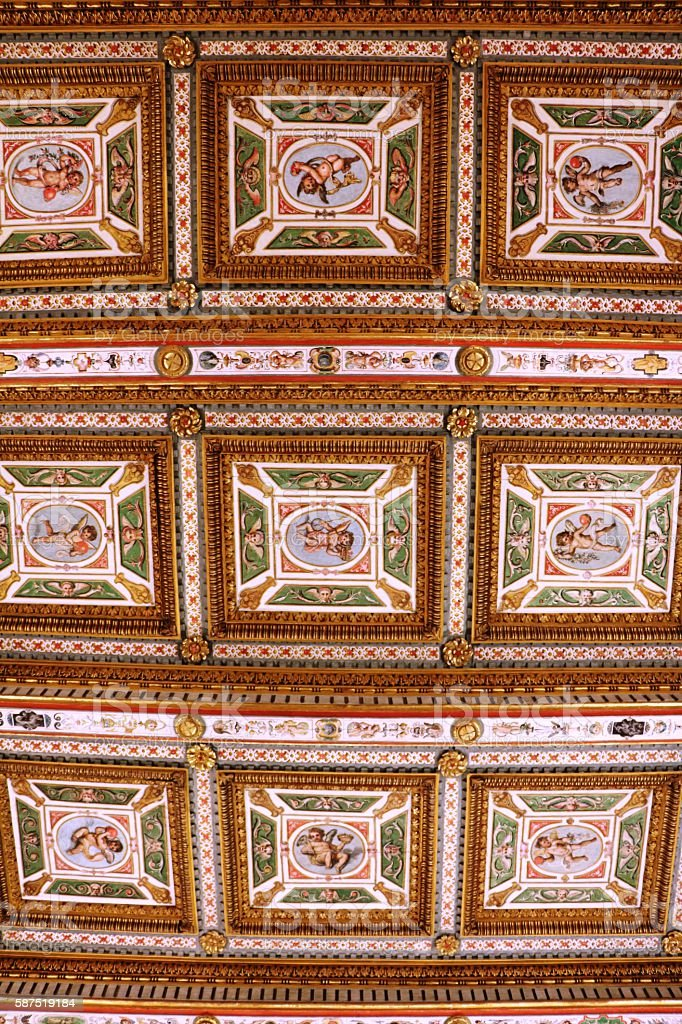 Upwards view to historical ceiling painting in Tuscany Italy stock photo