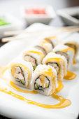 Uramaki sushi bonita maki on a dish