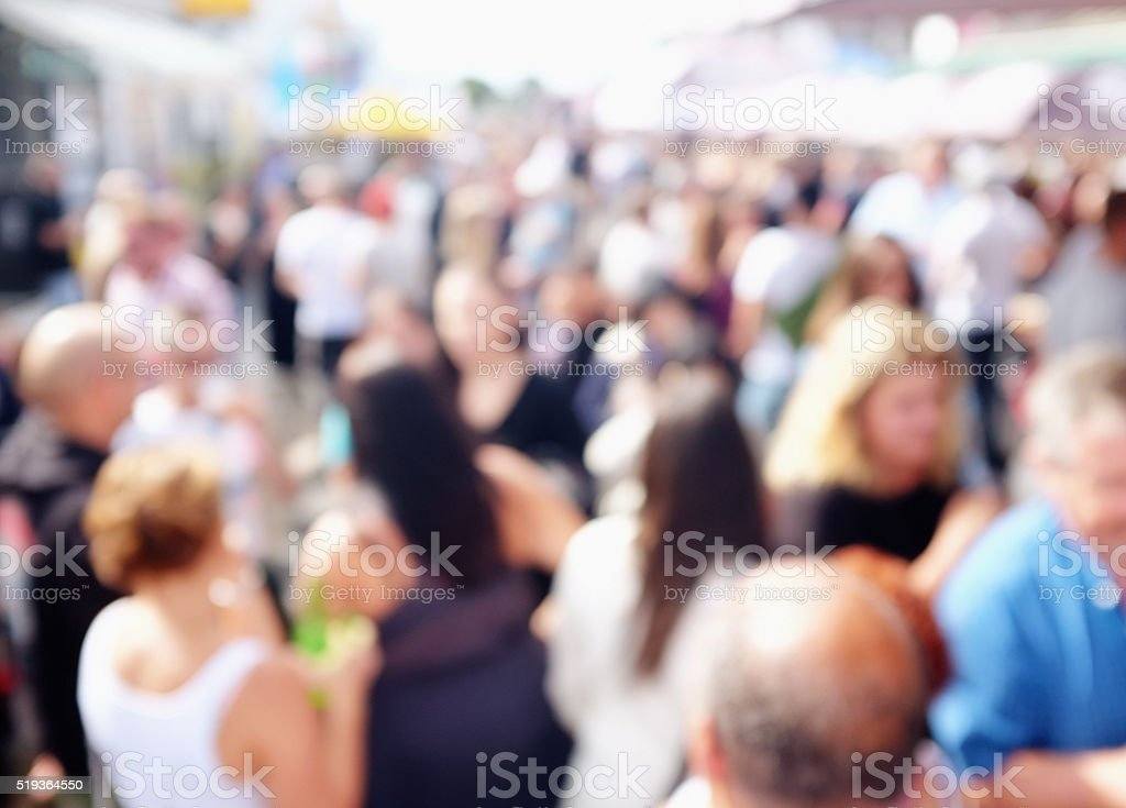 Urban background of blurred people in the street stock photo
