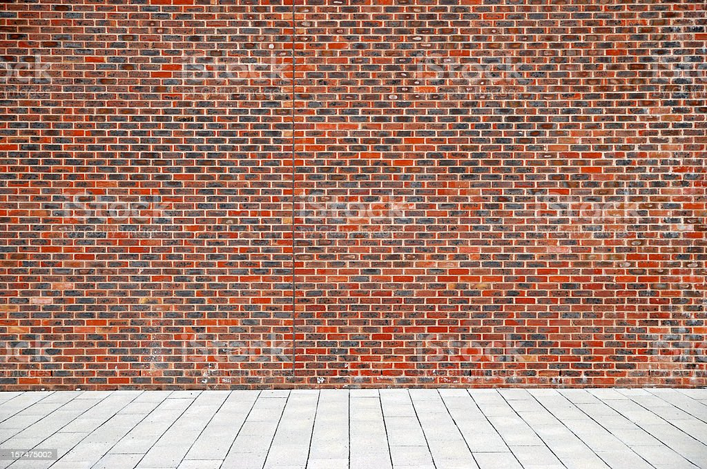 Urban background UK - Red brick wall with sidewalk stock photo
