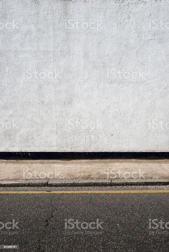 Urban background UK - Wall with sidewalk royalty-free stock photo