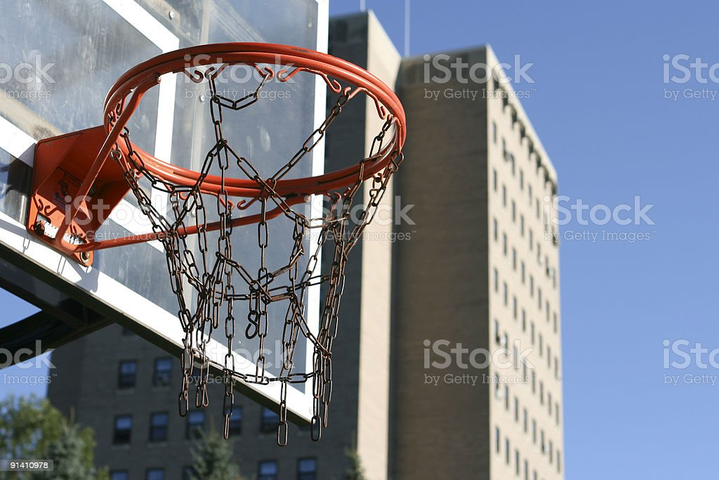 Urban Basketball Hoop with Building royalty-free stock photo