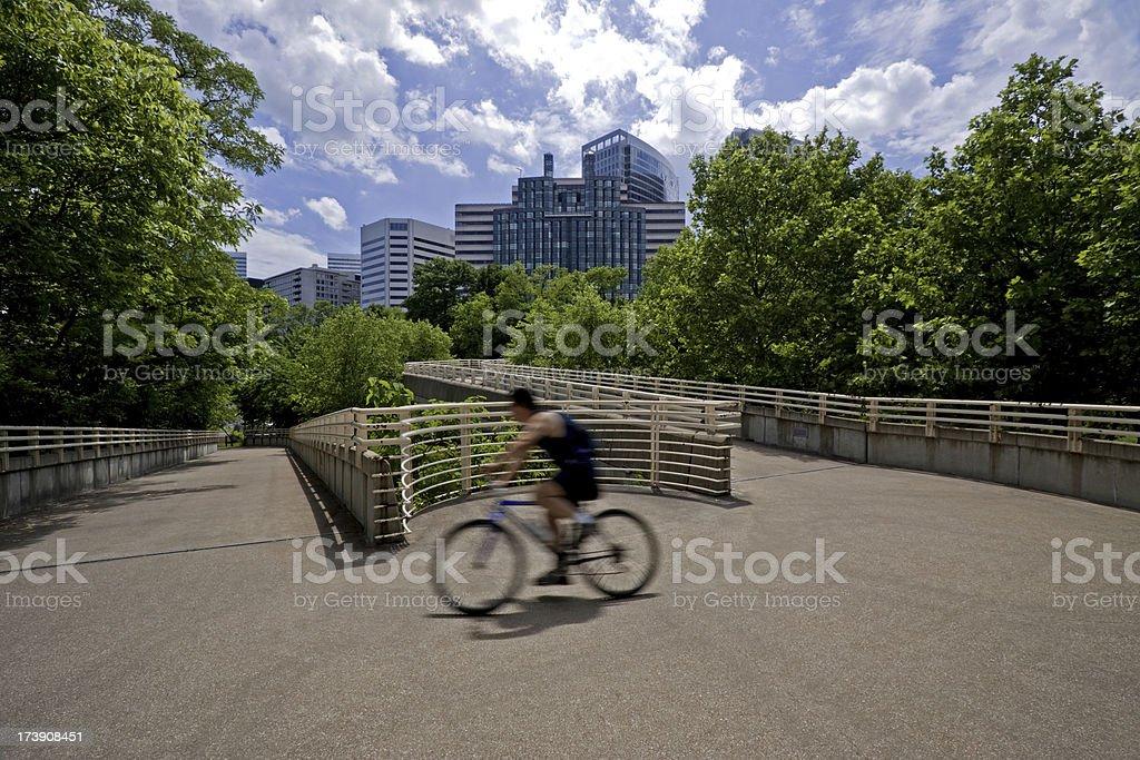 Urban bicyclist in the Rosslyn neighborhood of Arlington, Virginia stock photo