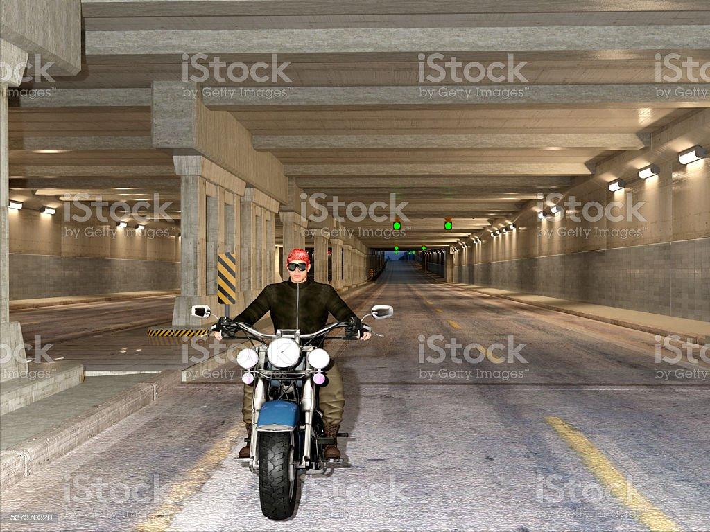 Urban biker in the tunnel stock photo