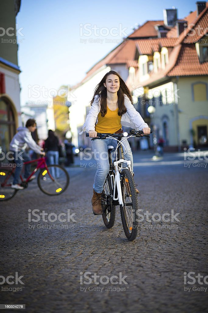 Urban biking- girl and bike in city royalty-free stock photo