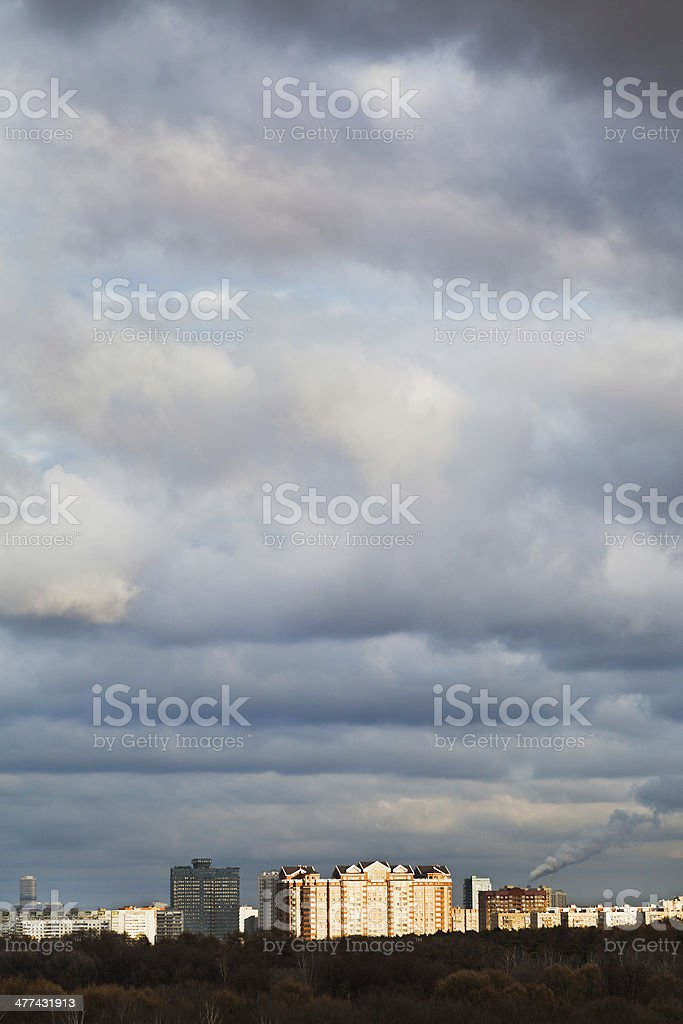 urban buildings under blue evening clouds royalty-free stock photo
