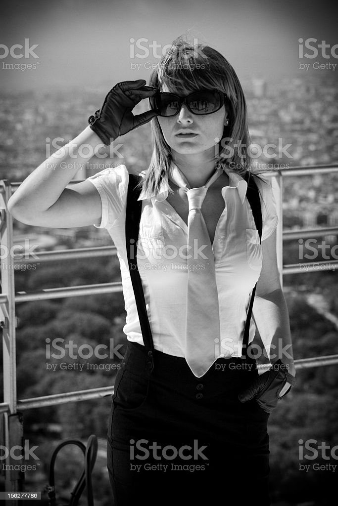 Urban Businesswoman Standing on Rooftop Over City royalty-free stock photo