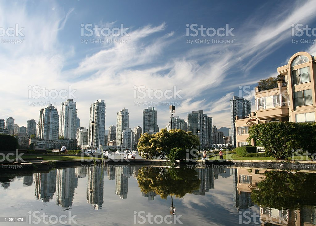 Urban cityscape and a lake at daytime royalty-free stock photo