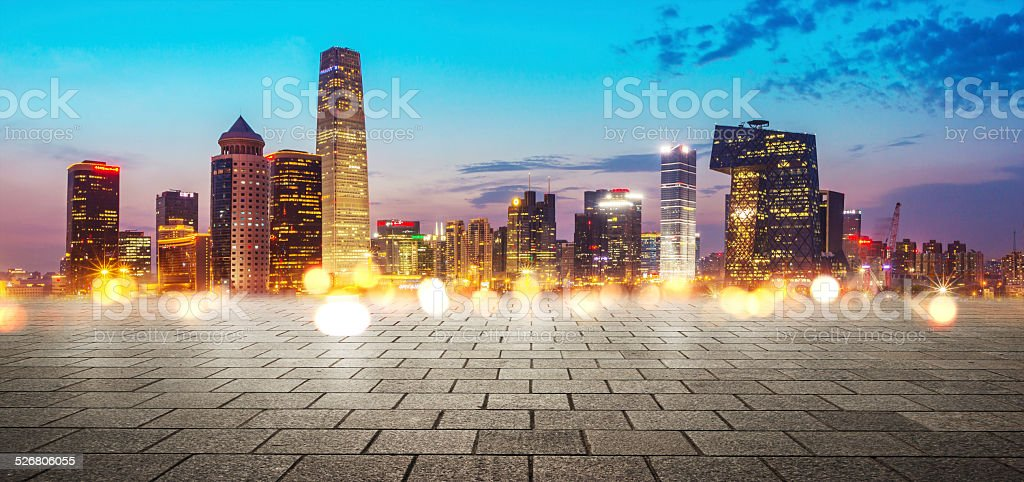 Urban cityscape, skyscrape with plank board in front at night stock photo