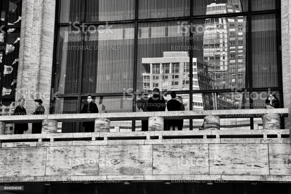 Urban Cultural Life, New York City, USA. People waiting for a matinee performance outside of Lincoln Center theater, Upper West Side, Manhattan. stock photo