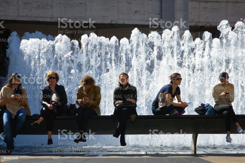 Urban Cultural Life, New York City, USA. Women waiting for a matinee performance outside Lincoln Center, Upper West Side, Manhattan. stock photo