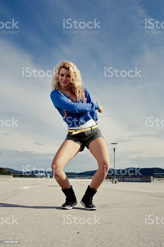 Girl dancing on the roof of the garage