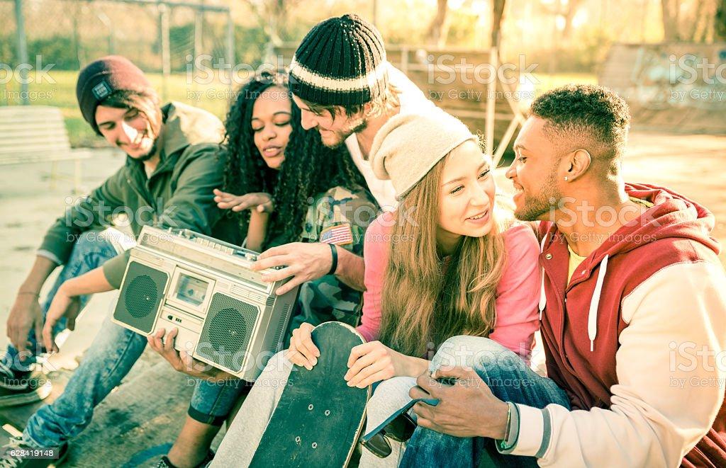Urban friends group having fun time at skate park stock photo