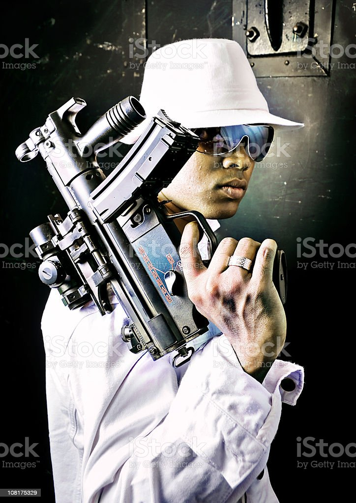 Urban Gangster Man Holding Uzi Machine Gun stock photo