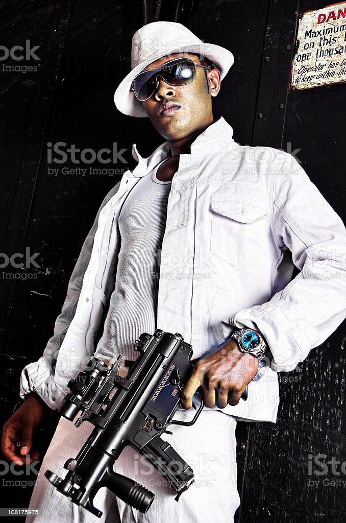 Urban Gangster Man Holding Uzi Machine Gun royalty-free stock photo