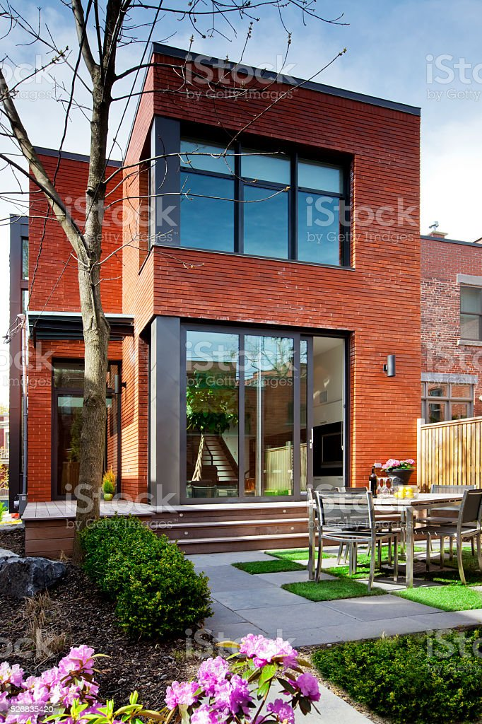 Urban garden of contemporary style townhouse in Spring stock photo