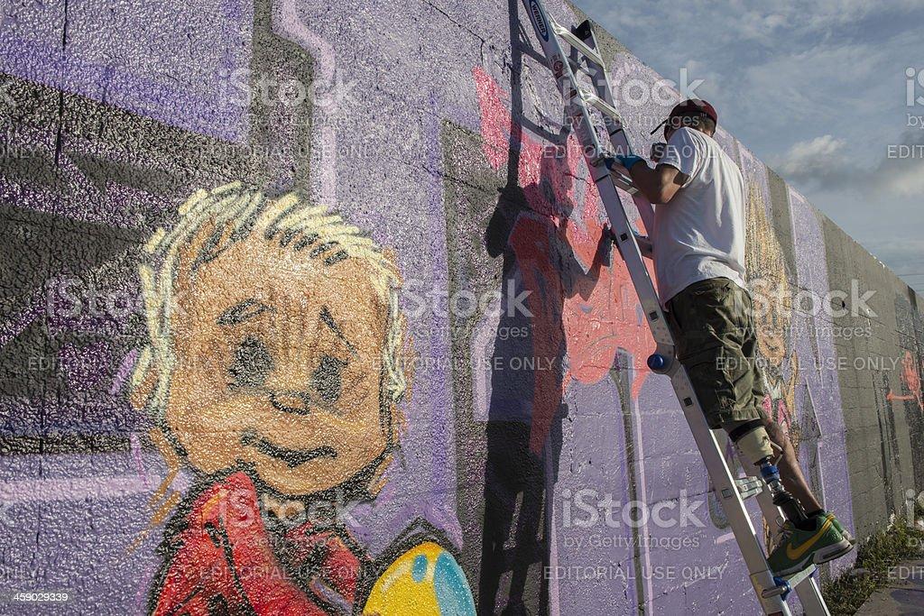 Urban Graffiti Artist With Prosthetic Leg in Wynwood Miami royalty-free stock photo