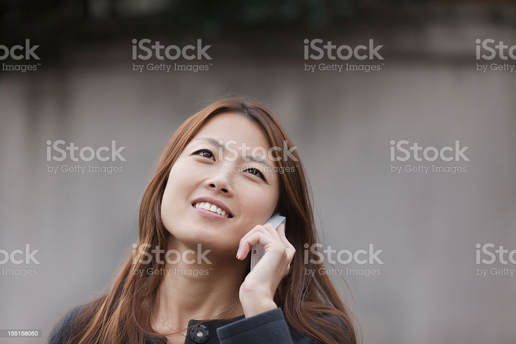 Urban Japanese Businesswoman talking on the phone royalty-free stock photo