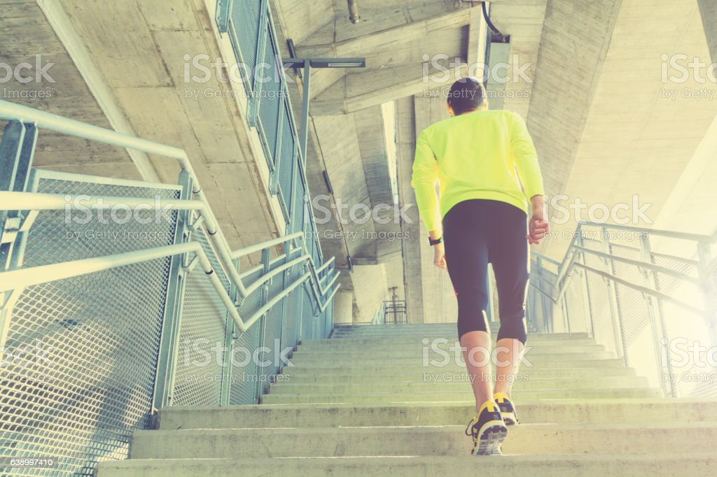 Urban jogger on a big bridge. stock photo
