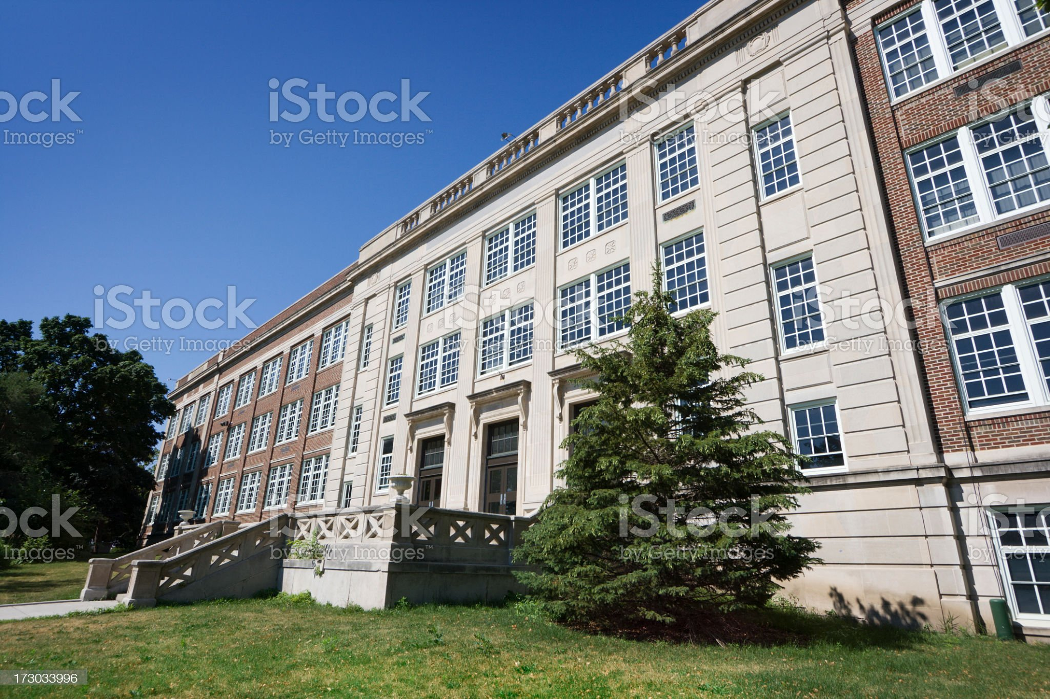 Urban Junior High School Building Facade and Front Steps Entrance royalty-free stock photo