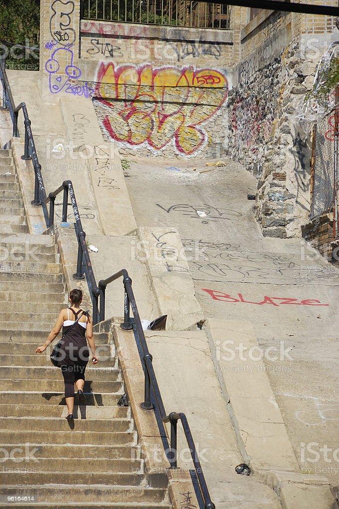 Urban Life, Bronx, New York City, Woman on steps, graffiti, royalty-free stock photo