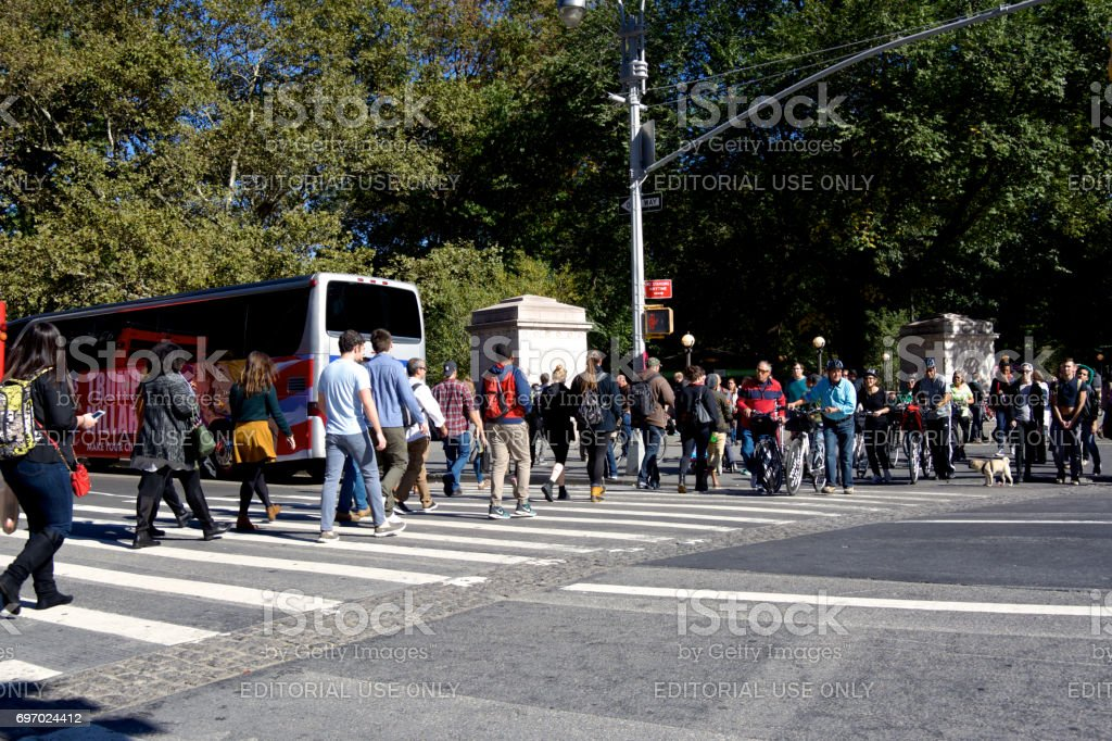Urban Life, New York City. Bicyclists and Pedestrians crossing Central Park West, Manhattan. stock photo