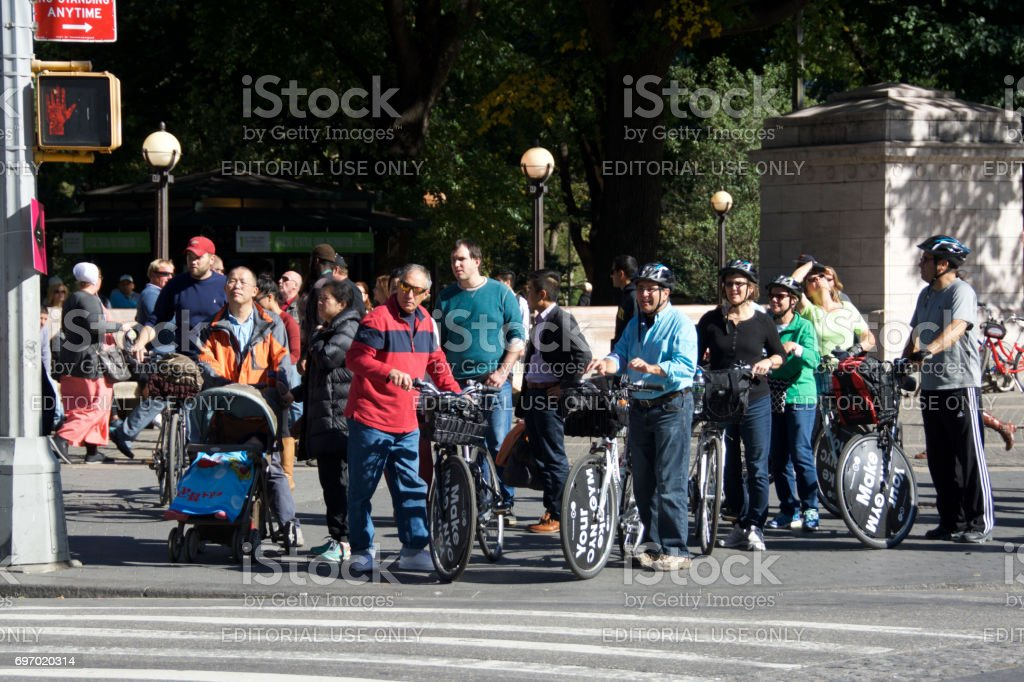 Urban Life, New York City. Bicyclists and Pedestrians waiting to cross Central Park West, Manhattan. stock photo