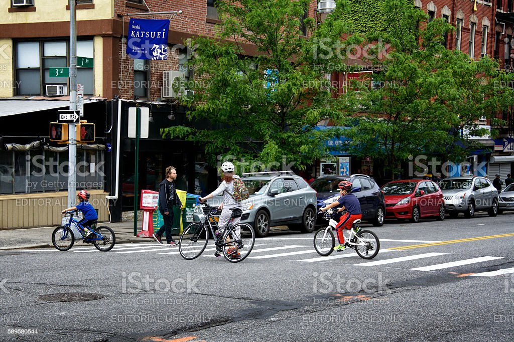 Urban Life, New York City, Family Bicyclists Crossing Street, Brooklyn stock photo