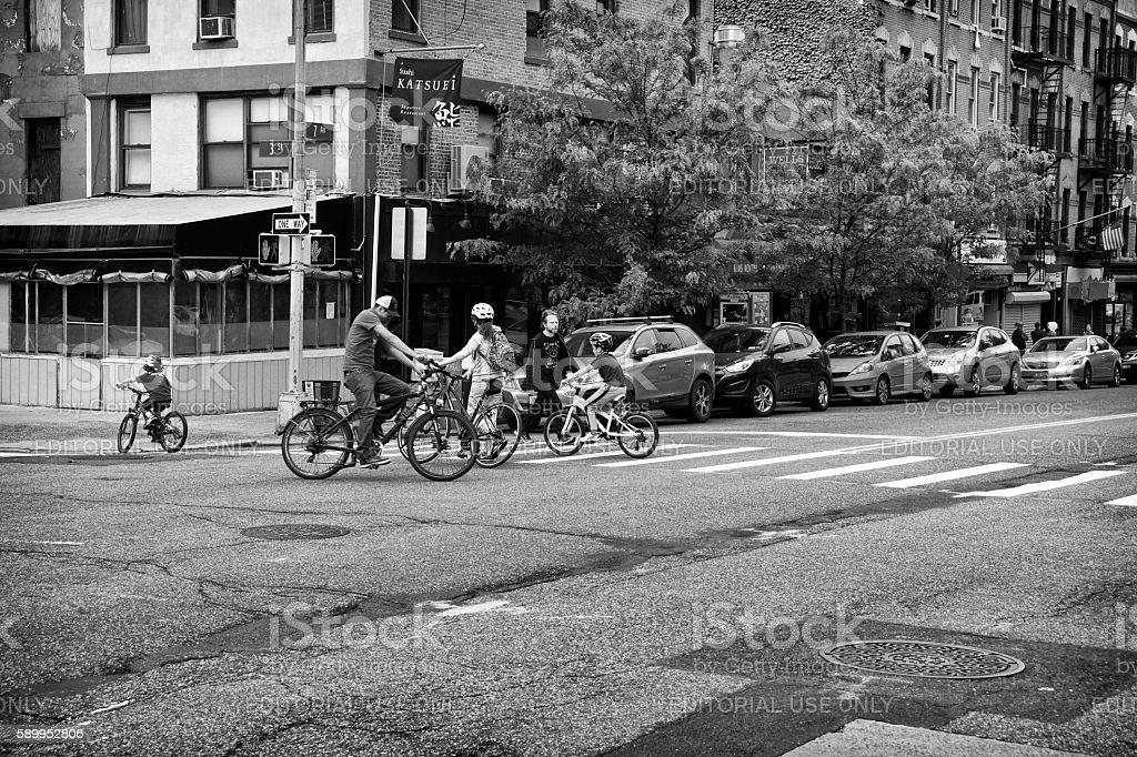 Urban Life, New York City, Family Bicyclists Crossing Street, Brooklyn stock photo
