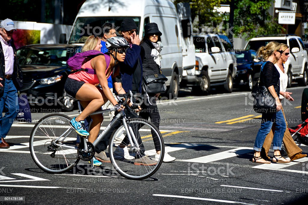 Urban Life, New York City, Female Bicyclist at Manhattan Intersection stock photo